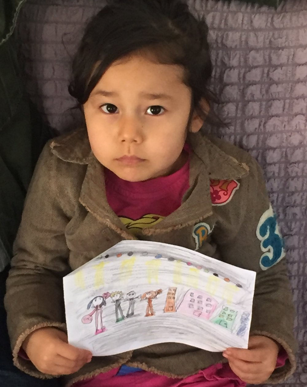 Access to education is another challenge. While Turkey provides access to schools, the cultural and language barriers make learning difficult and often lead to refugees dropping out of school. Pictured here, a 6-year-old Afghan refugee in Aksaray shows RI her artwork.