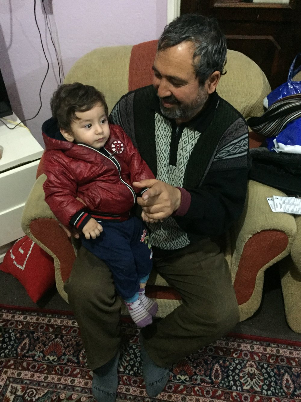 Ali, a 48-year-old Afghan asylum-seeker with his grandson in Kayseri, Turkey.