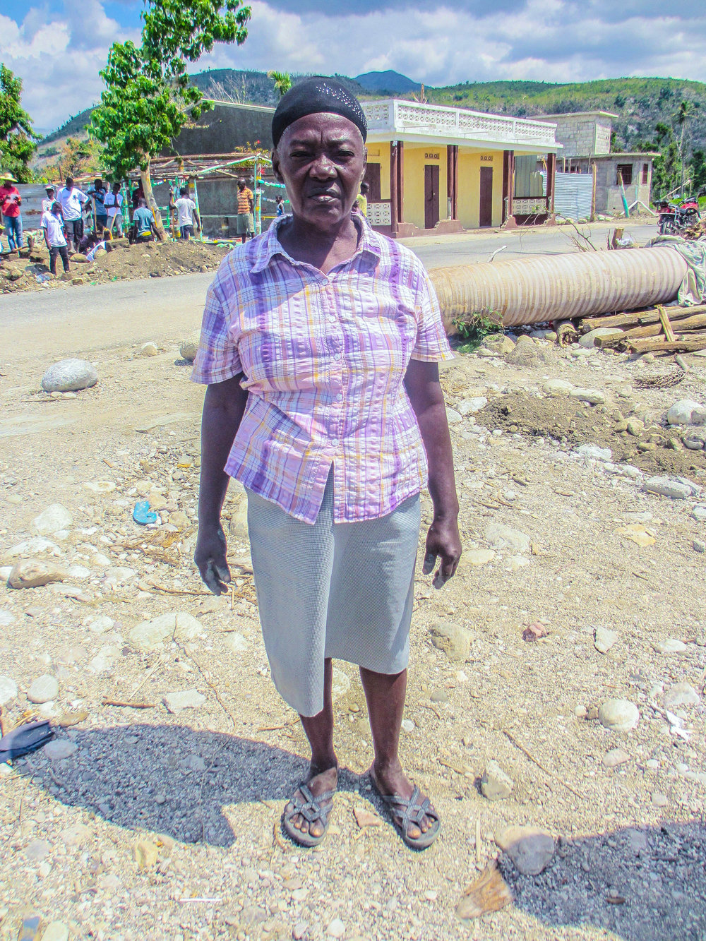 Standing in the spot where her house once stood, a mother explains that she has no resources to rebuild the home destroyed by Hurricane Matthew.