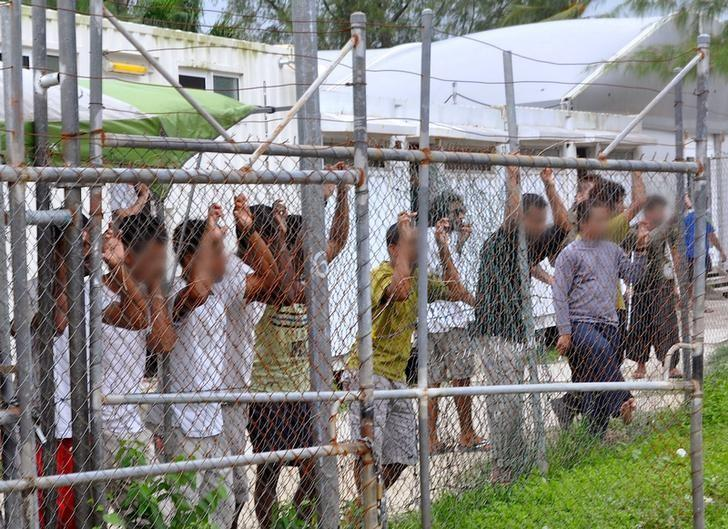 Credit: Reuters. Asylum-seekers at Manus Island detention center, Papua New Guinea, 2014.