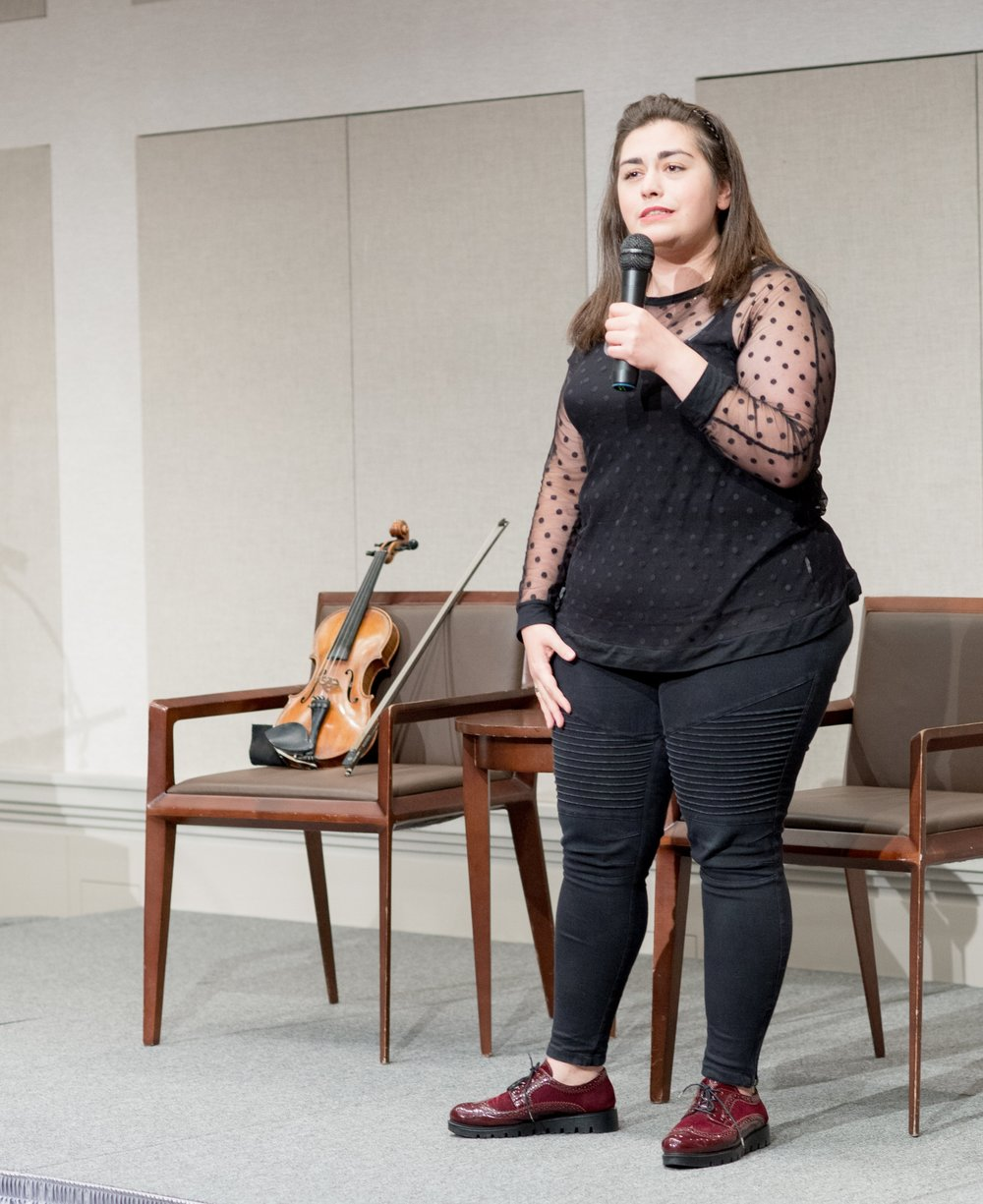Mariela Shaker, celebrated Syrian violinist and refugee from Aleppo, performed at the event.
