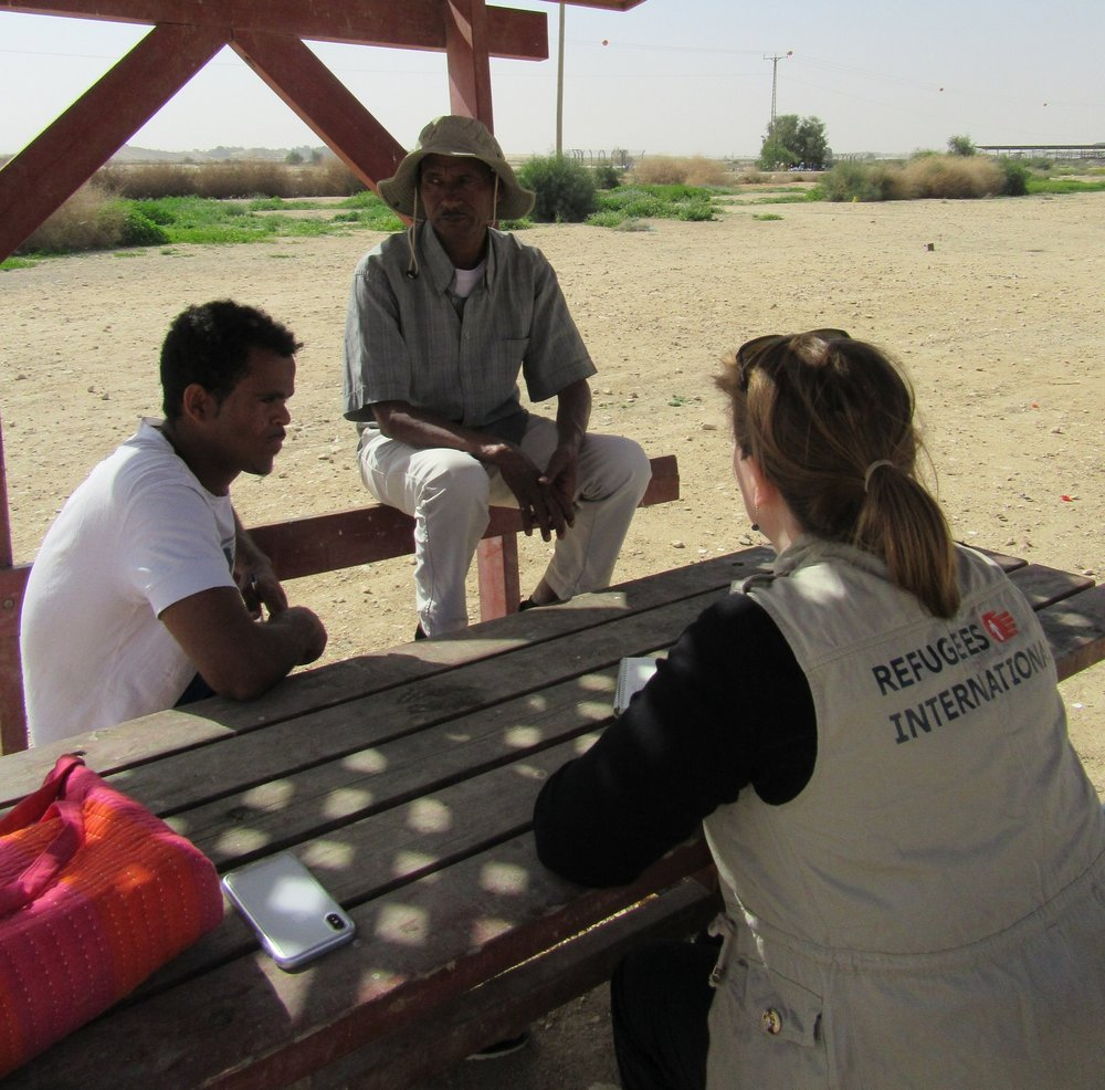 RI staff member interviewing asylum seekers near the Holot Detention Center