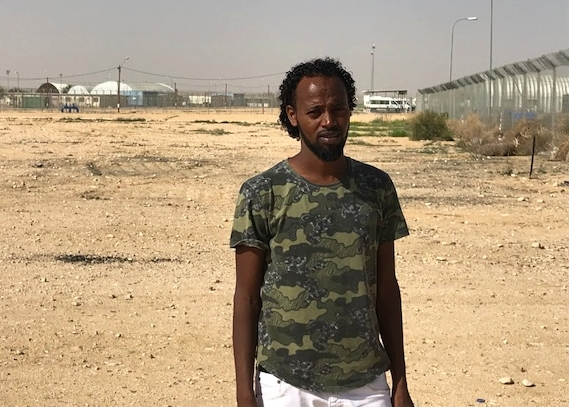Asylum seeker outside of the Holot Detention Center