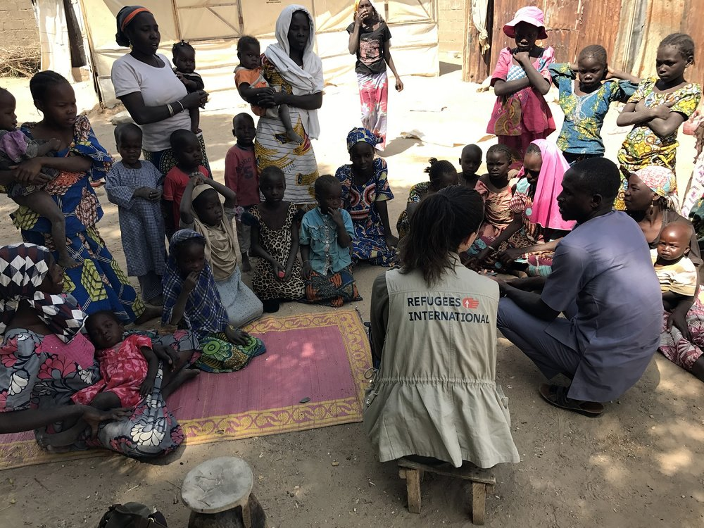 Alexandra Lamarcha, RI's Advocate for Sub-Saharan Africa and Peacekeeping speaks to children in a refugee camp in Nigeria.