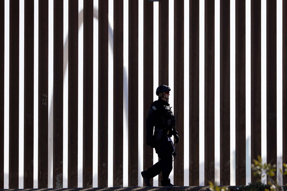 AP Image - U.S. Customs and Border Protection Special Response Team officer - Tijuana, Mexico .jpg
