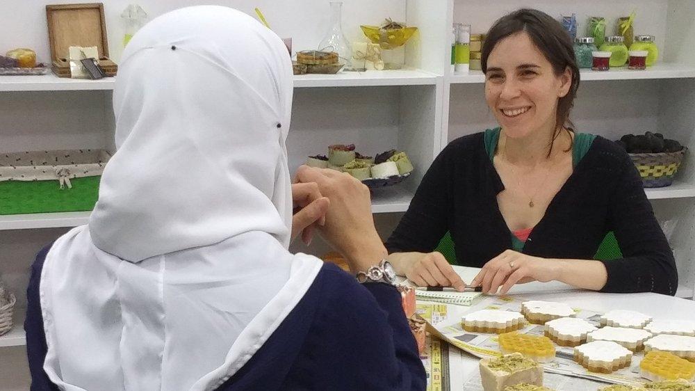 RI Advocate, Izza Leghtas, speaks to a Syrian refugee in Jordan.