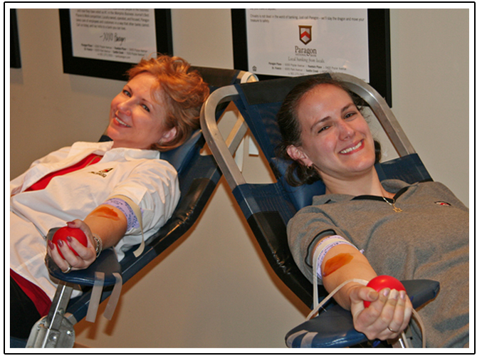 Charlene Franklin and Nadine Goldin participate in a Paragon blood drive.