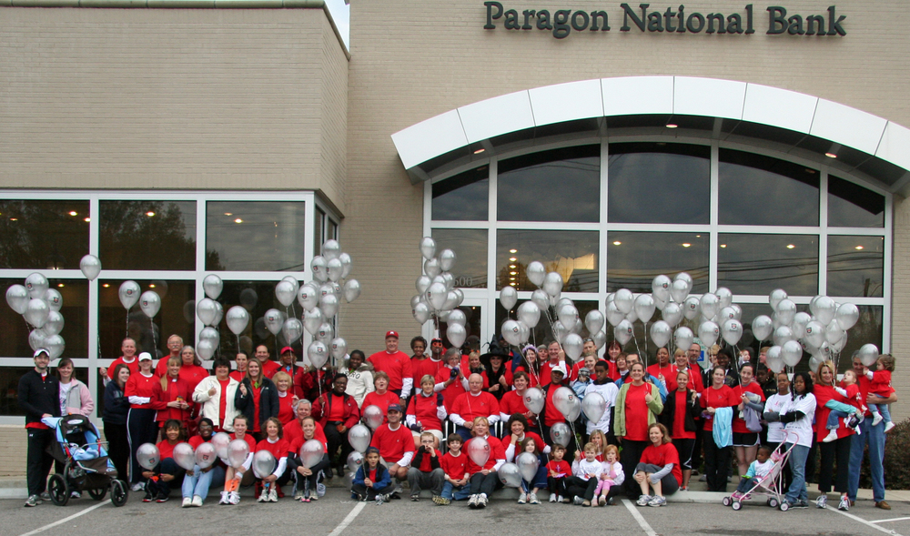 Paragon employees and their families gather at the Saddle Creek banking center before the start of the race.