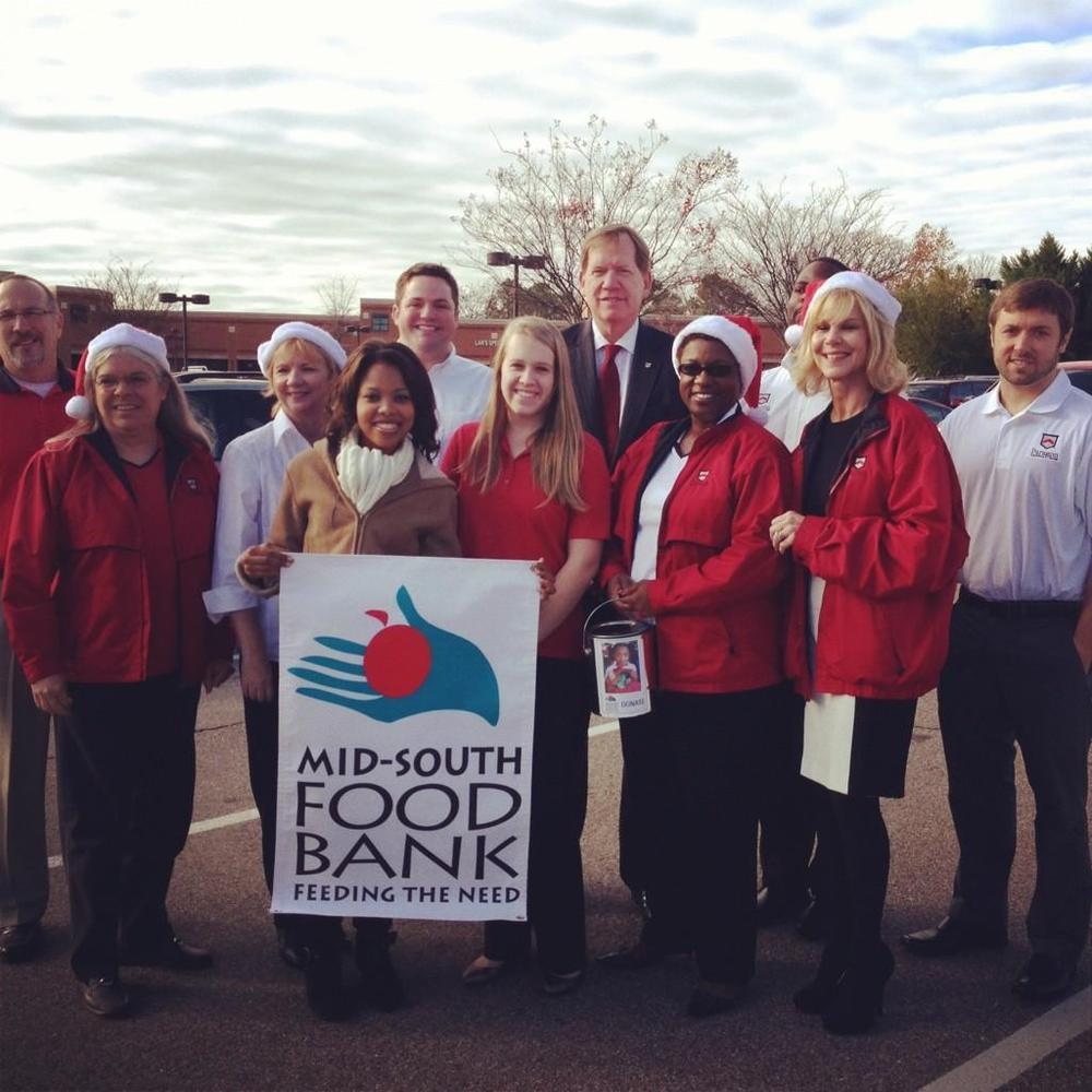 Paragon Employees donate to the Food Bank on WMC-TV.