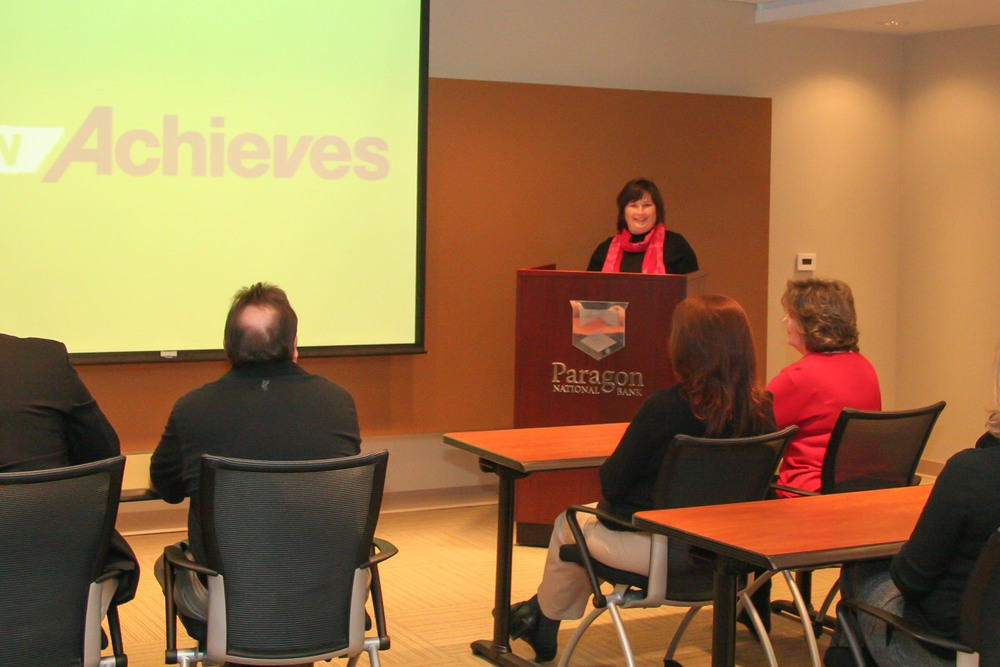Tracey Thesmar talks to Paragon employees about the tnAchieves program.