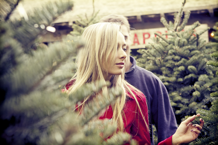 Young couple picking out a Christmas tree.