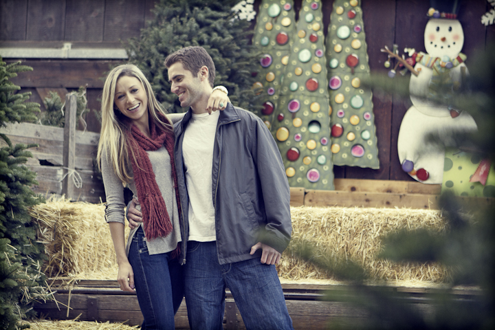 Young couple hanging out in a holiday scene.