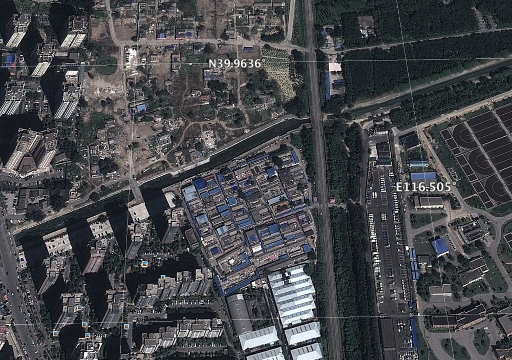 Location of a demolished area. In the East is the railway, which can be seen in one of the photos.  - Satellite photo: Google Earth (on the 11th of October, 2013)