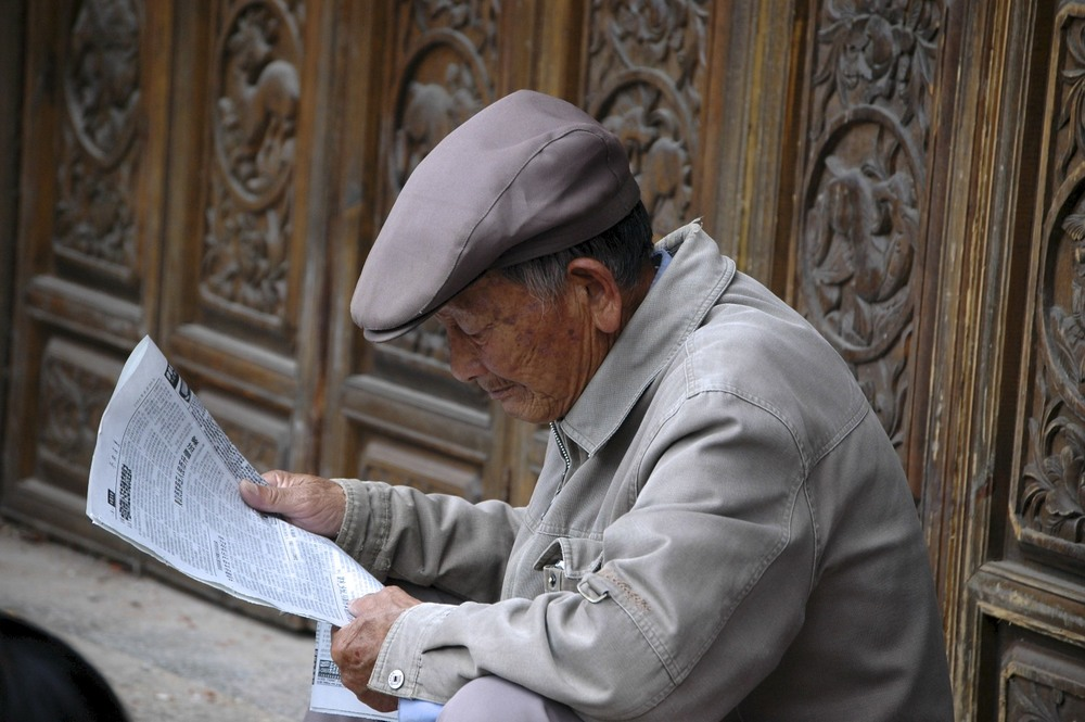 Man reading the news