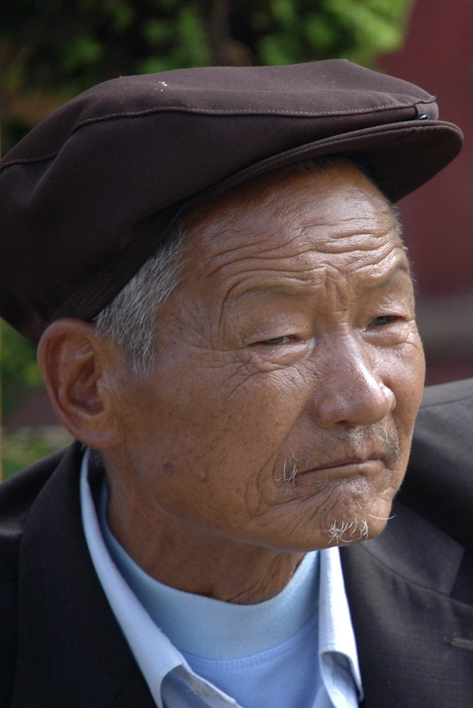 Man with duck nose cap in Yunnan
