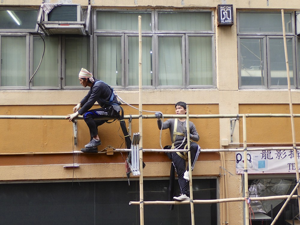 Construction workers in Wanchai. I love the practical spirit in Hong Kong. Though this one looks a bit unstable, it is perfectly save. Perhaps.