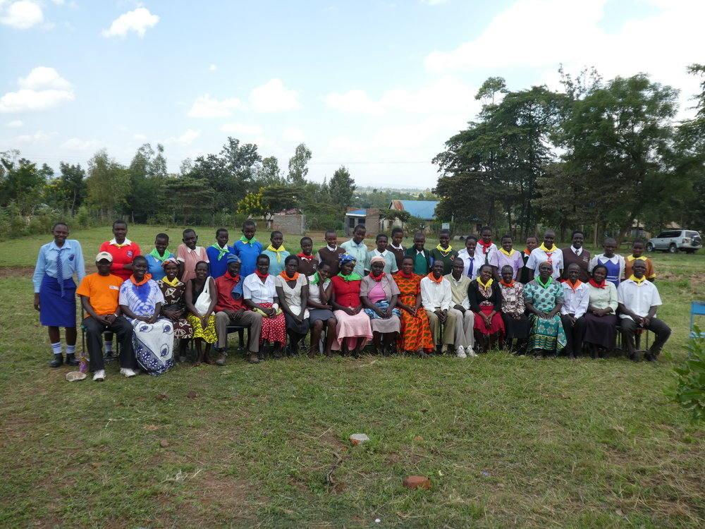 Students and parents engage together at a mentorship day in St. Mary's Kachar Secondary Girl's School.