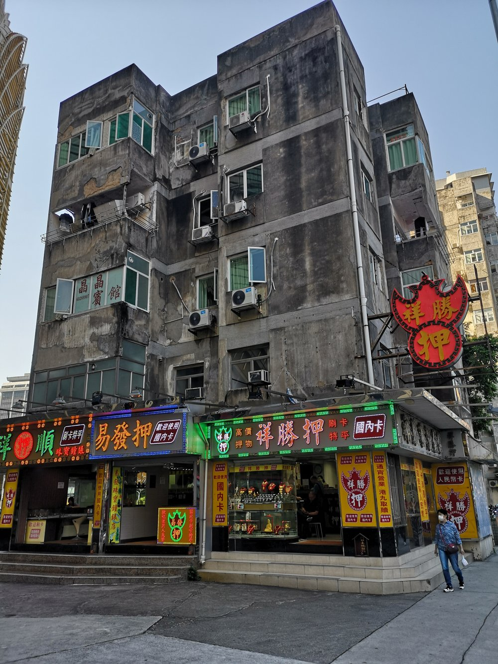 The really powerful places in Macau are the Pawn Shops. They can afford to stay in prime locations, with these kinds of buildings and they won't sell. For what?