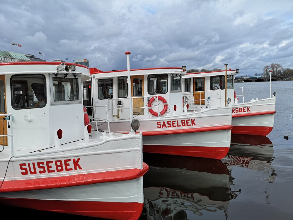 Tourist boats pausing in the rain in Binnenalster.