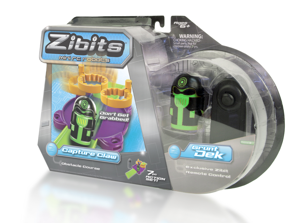 Zibits 'Capture Claw' Package Design  [Image 1/1]  Client: Senario LLC  We also we worked with the Woodstock, IL based toy company Senario LLC, to assist in the production of packaging for their Zibits brand of RC toys. We helped develop new copy and graphics for use on the company's expanded line of playsets.