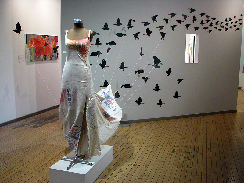 Installation view of 'The Real Cinderella Dress'. (Martha Keller's red amaryllis painting on left wall.)