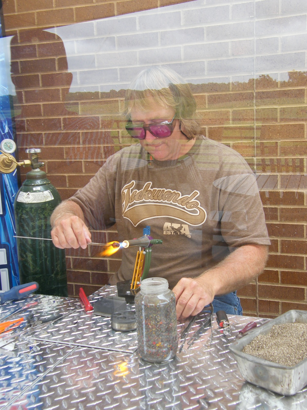 Chris Witulski with his cool lampwork torch, making marbles