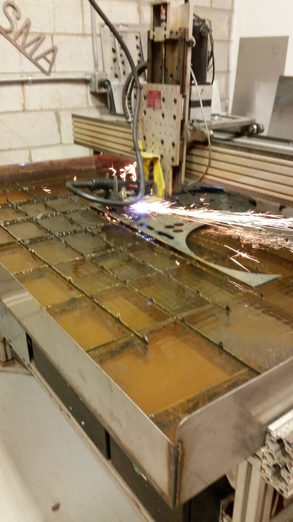Plasma cutter cutting steel, computer driven