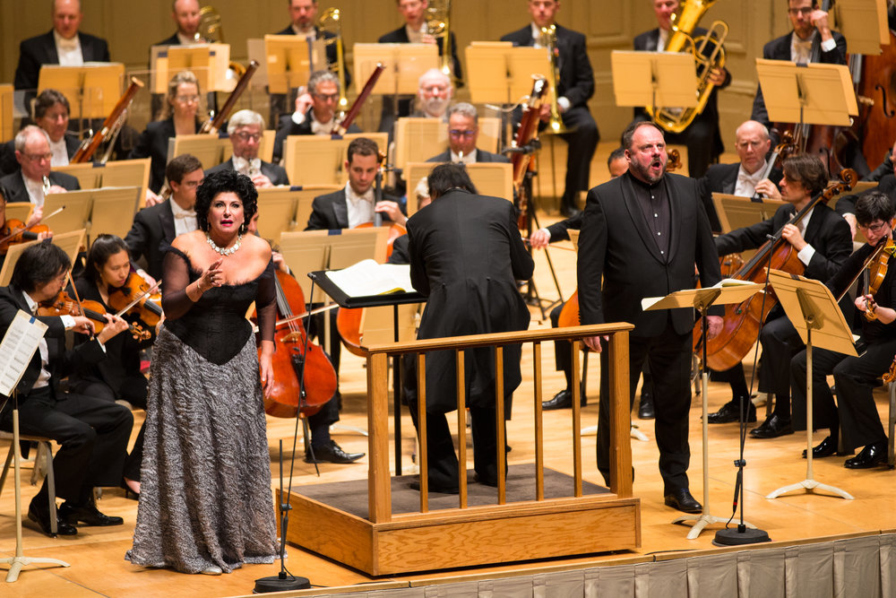 "Mezzo Ildiko Komlosi, baritone Matthias Goerne, conductor Charles Dutoit and the Boston Symphony Orchestra in Bartok's ""Duke Bluebeard's Castle."" Oct. 28, 2016.   Robert Torres photograph."