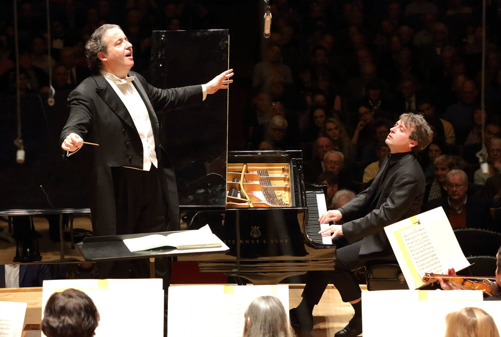 Juanjo Mena conducts the Boston Symphony Orchestra with pianist Jean-Frédéric Neuburger, Thursday, Jan. 26 at Symphony Hall. Hilary Scott photograph.