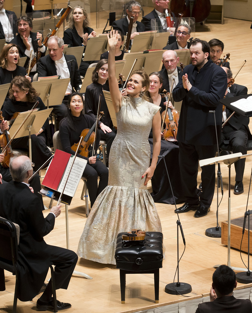 Friends in the balcony? Soprano Kristine Opolais waves after Mahler's Fourth, with Andris Nelsons and the Boston Symphony Orchestra. Winslow Townson photograph.