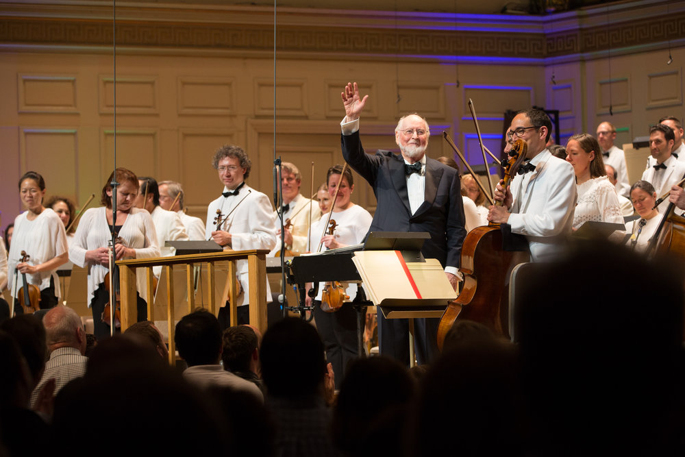 John Williams waves from the stage after leading the Boston Pops at Symphony Hall, Wednesday, May 31. Michael Blanchard photograph.