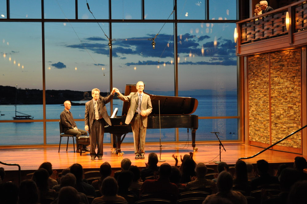 "Composer and pianist David Alpher (left) takes a bow with baritone Robert Osborne after the premiere of ""Between Twilights,"" settings of poems by Marsden Hartley, Saturday evening at the Rockport Chamber Music Festival. Karen Herlitz photograph."