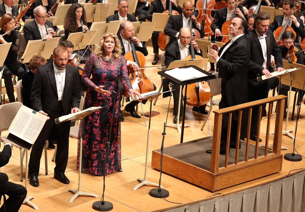 Tenor Paul Groves (left) as Faust, mezzo Susan Graham as Marguerite, bass-baritone John Relyea as Méphistophélés (far right). Charles Dutoit conducts the Boston Symphony Orchestra, Oct. 26, 2017. Hilary Scott photograph.