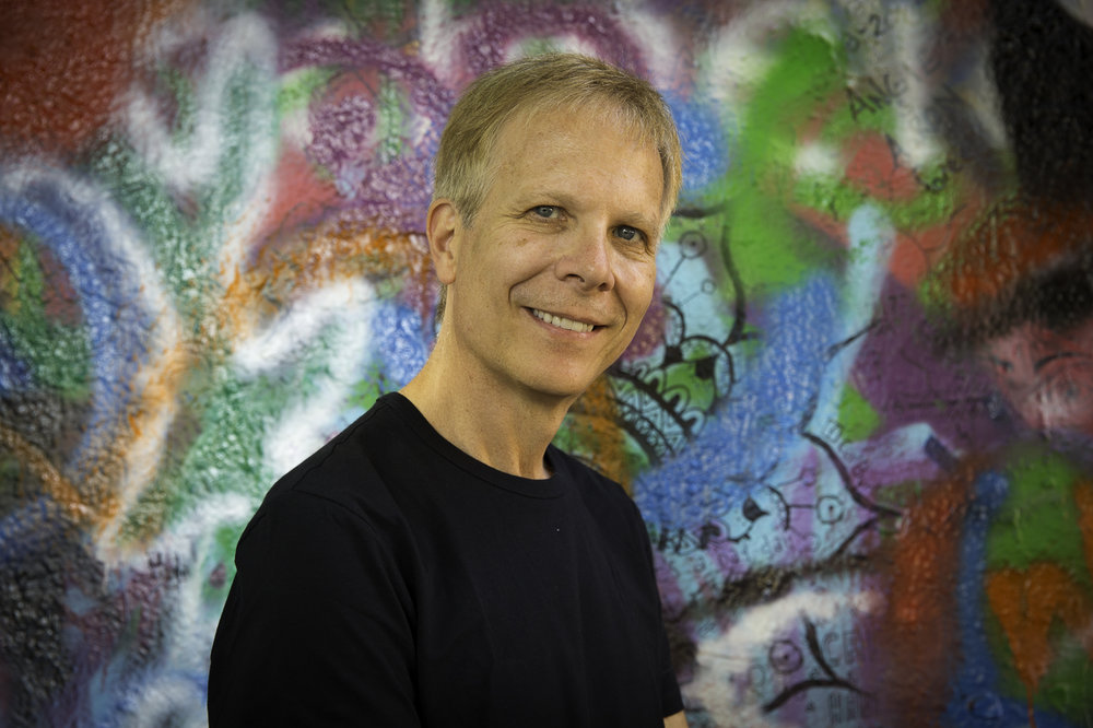 Terezín Music Foundation's Mark Ludwig, at the Lennon Wall.