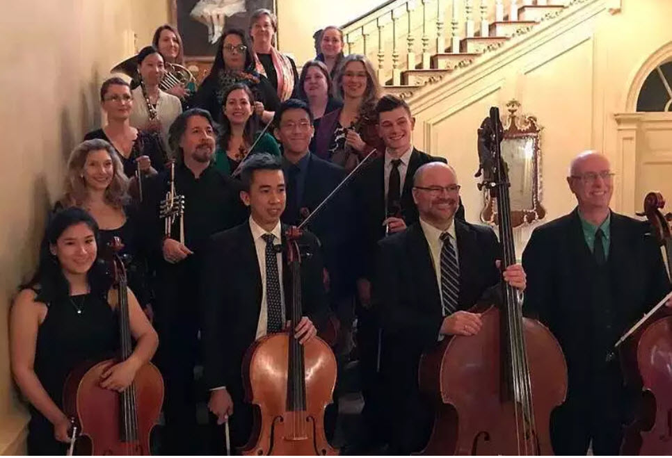Ipswich's The Orchestra on the Hill, with director Tom Palance (center-left, with trumpet)