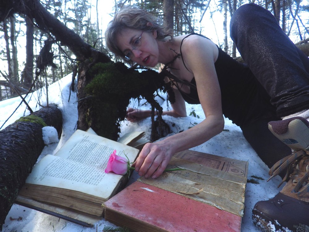 """Kate Tarlow Morgan, """"dancing with books,"""" poses in her Invisible Stories Winter."""