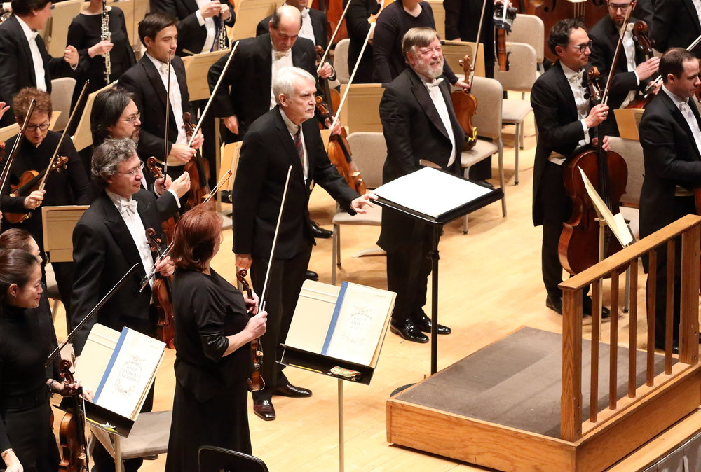 John Harbison bows, with Sir Andrew Davis and the Boston Symphony Orchestra, after the Jan. 11 performance of his Second Symphony.