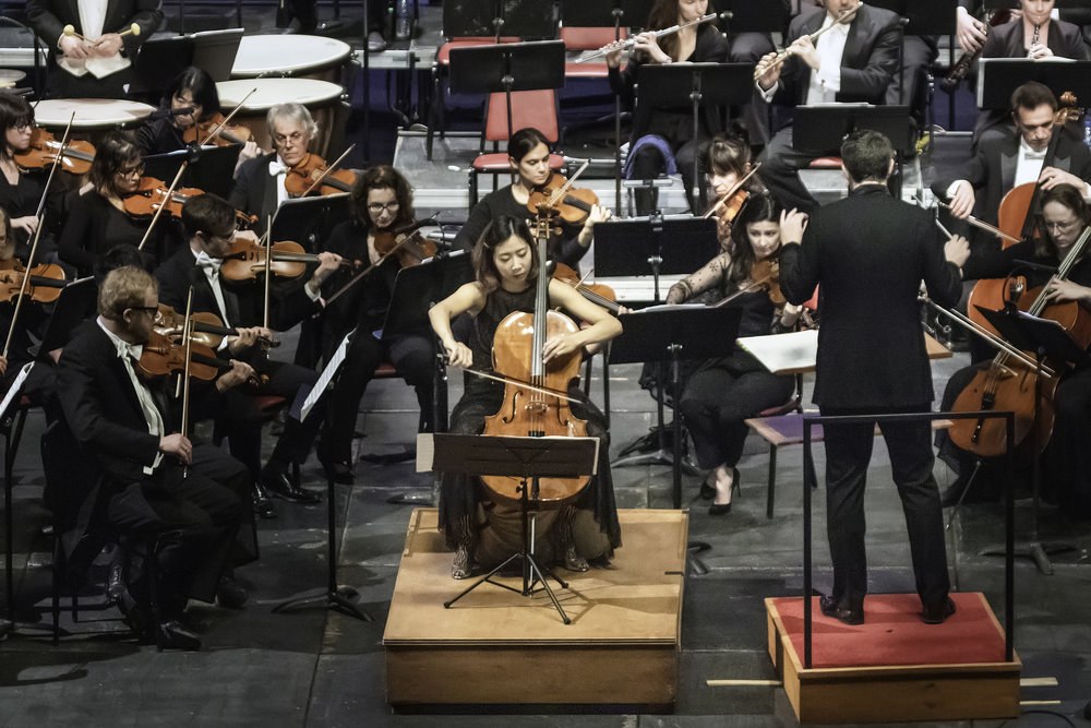 "Christine J. Lee performs Andrea Tarrodi's cello concerto ""Highlands"" with the New Bedford Symphony Orchestra. Yaniv Dinur conducts. Richard Van Inwegen photograph"
