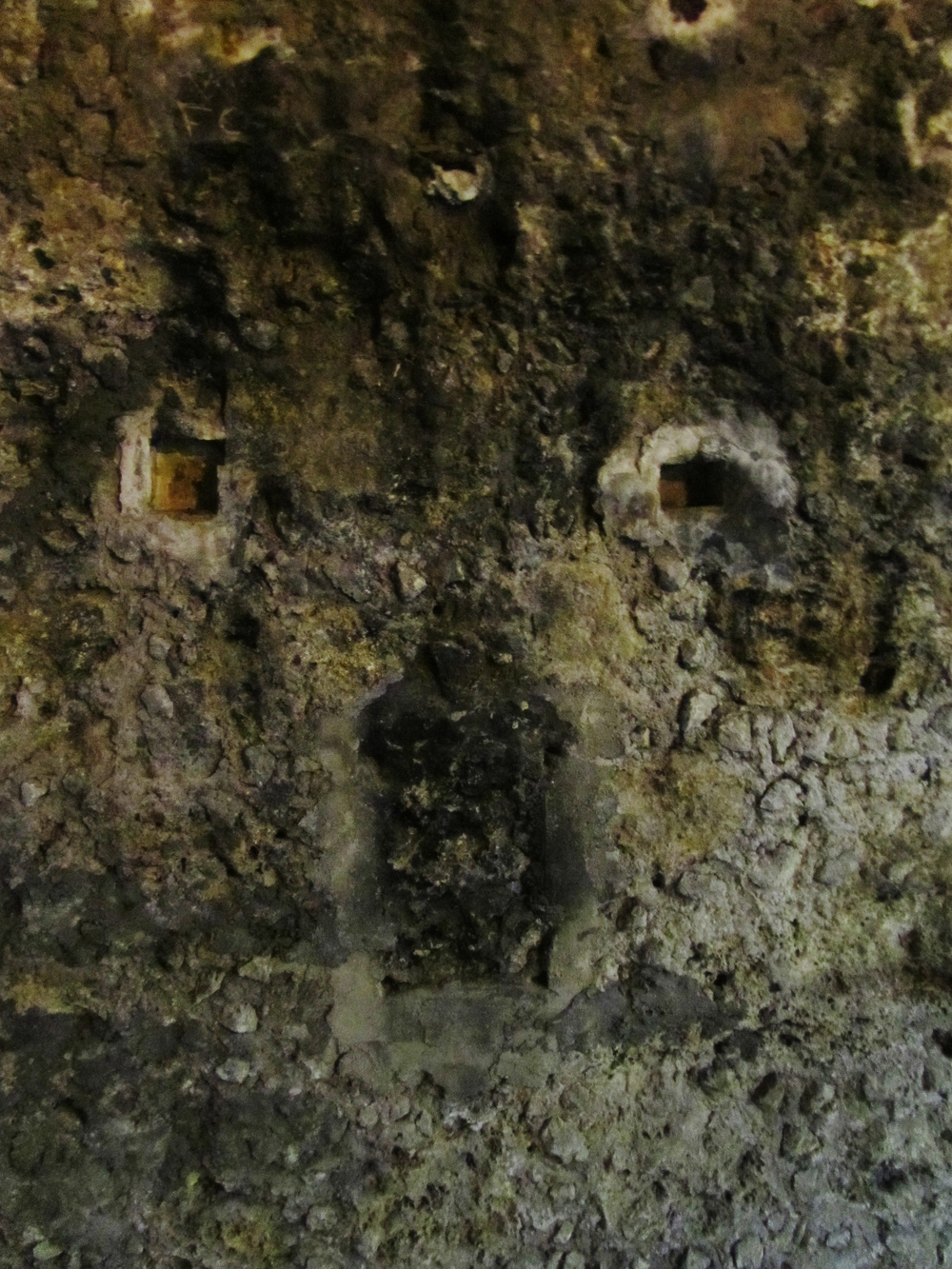 spooky rock face paris catacombs.JPG