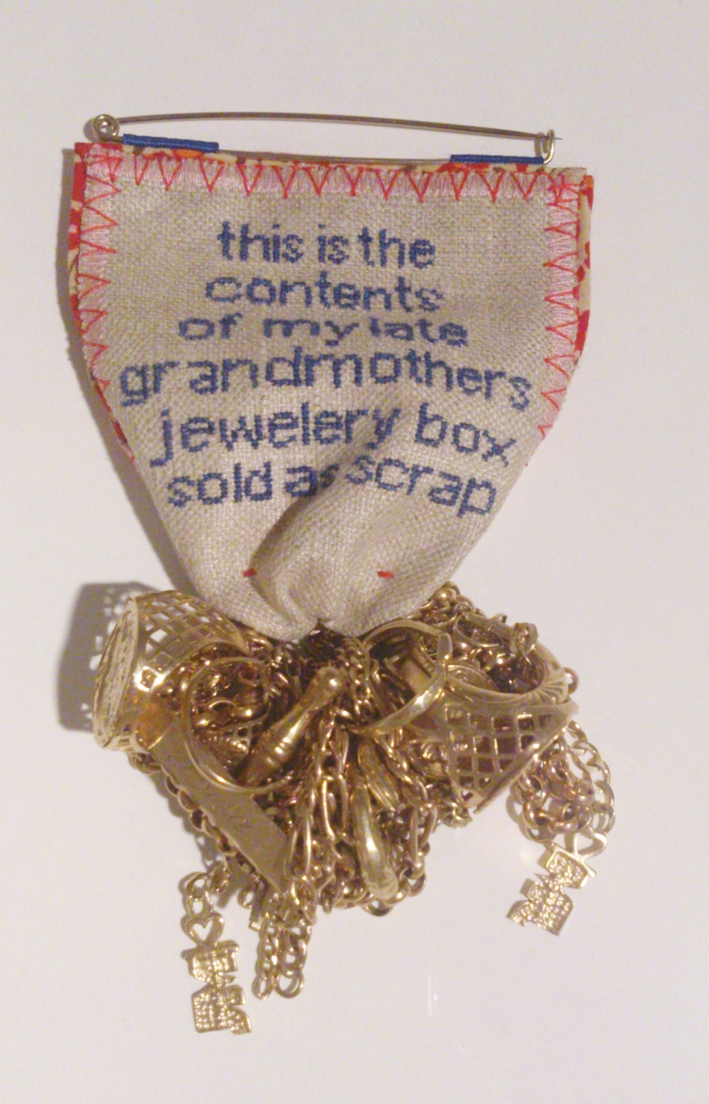 "Lifetime Medal 280100507863, 2007 Gold, linen, cotton Laura Potter ""In these lots of second hand jewellery I was looking for private sellers who were advertising old family pieces, and especially those who gave an insight into the emotional status of the items for sale. The embroidered quote is taken directly from the eBay listing: it contains no punctuation, no capitalisation and 'jewellery' is incorrectly spelled."""