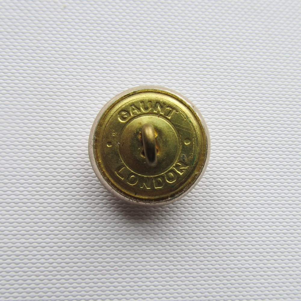The reverse side of my button, the maker is Gaunt London, est. 1884  known for their military buttons. This one is probably mid 20th Century
