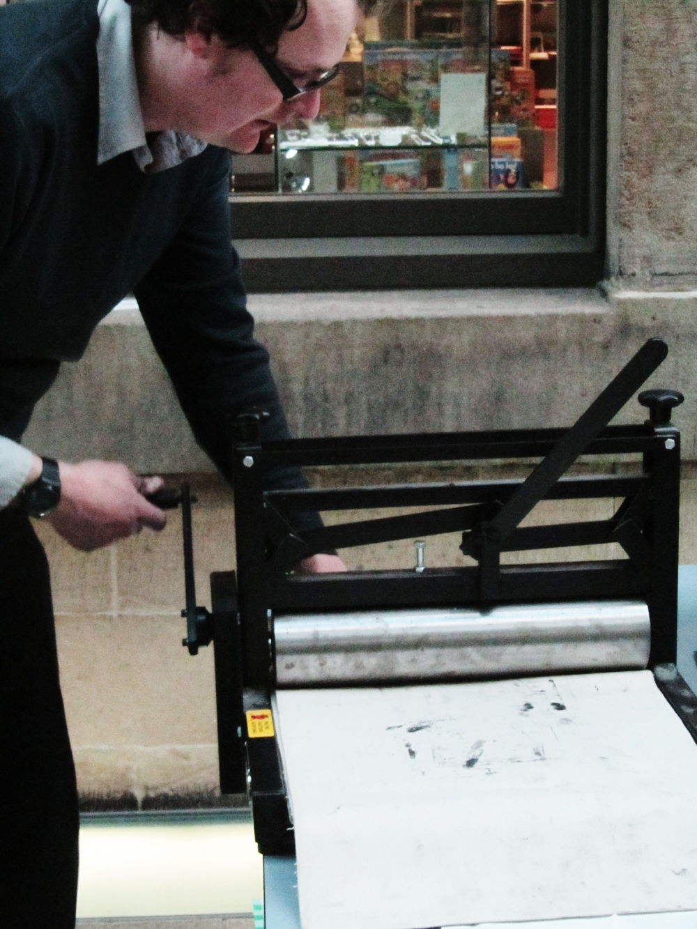 artist Adam Quinn rolling our prints.JPG