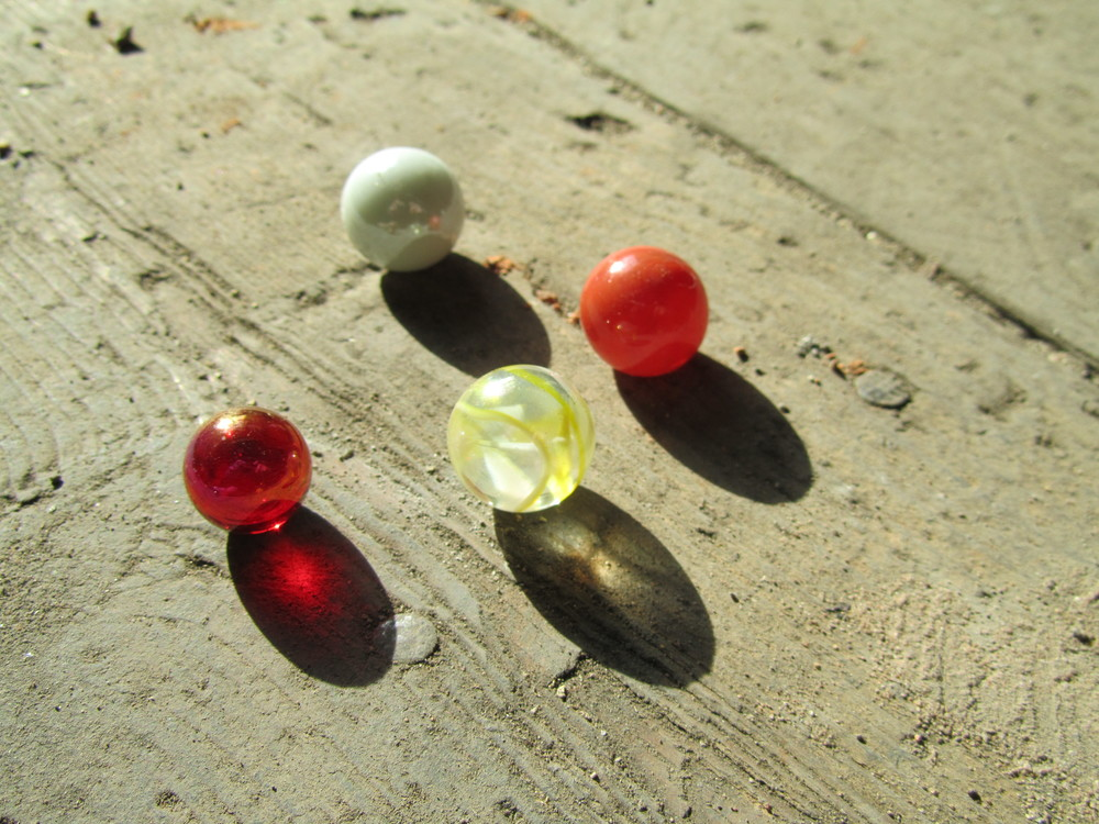 Playing marbles. The milky white one above was used in the Sweet Ruin Ring!