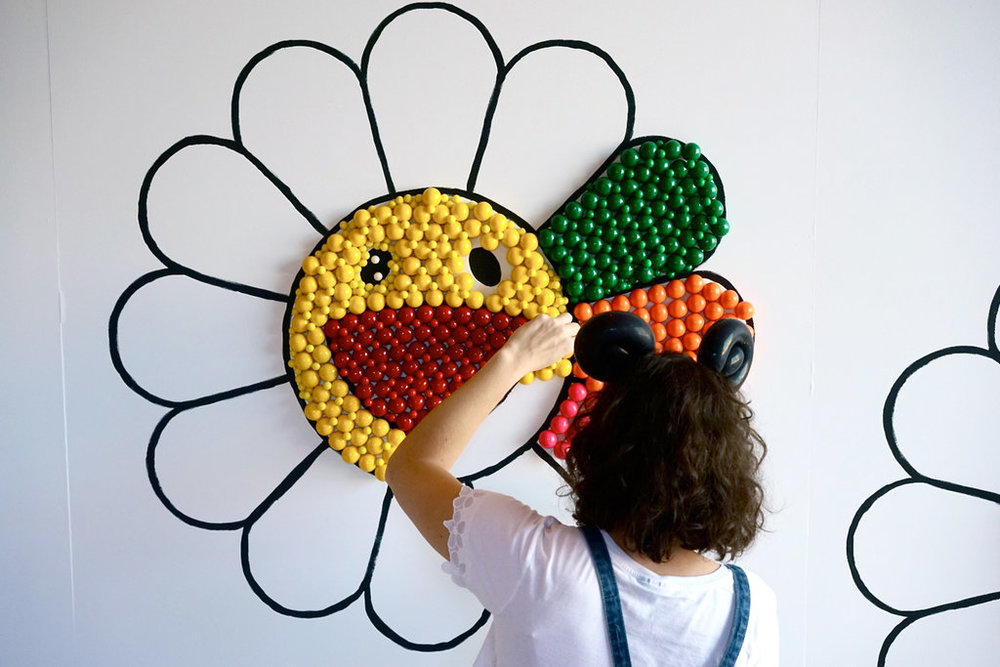 """The Murakami flowers have got to be one of my favourite things ever,""  Says Kassem. She chose these iconic smiling blooms for her installation created by sweets at Brooklyn Museum. Photo courtesy of Tmagazine."