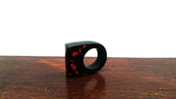 The patterns of the wings of the Cinnabar Moth inspired this red and black ring