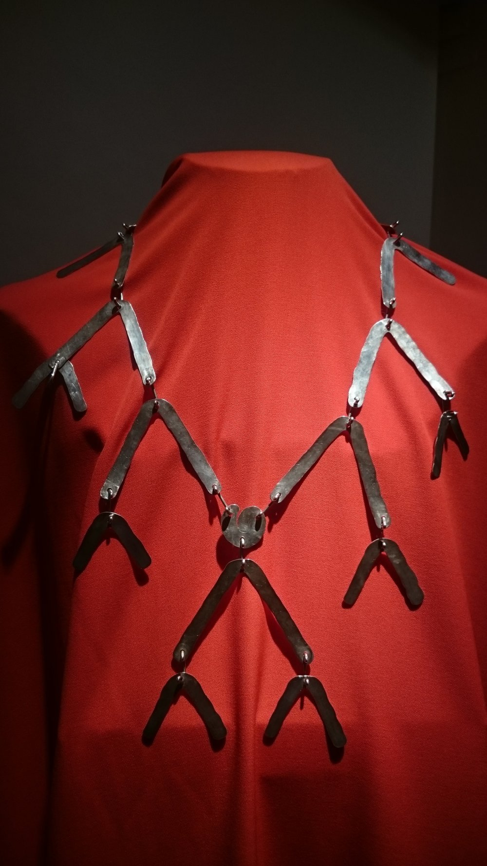 Connected components fit over the body in a Calder necklace