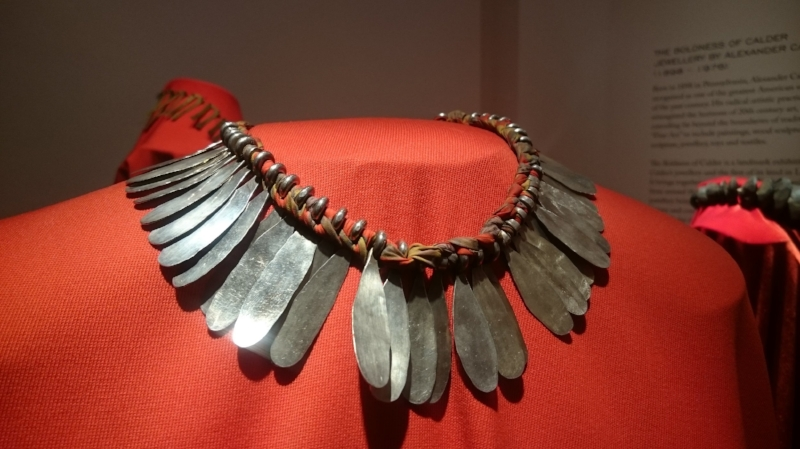 Calder necklace combining textiles and metal