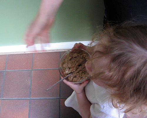 little girl with bowl of yummy chopped liver