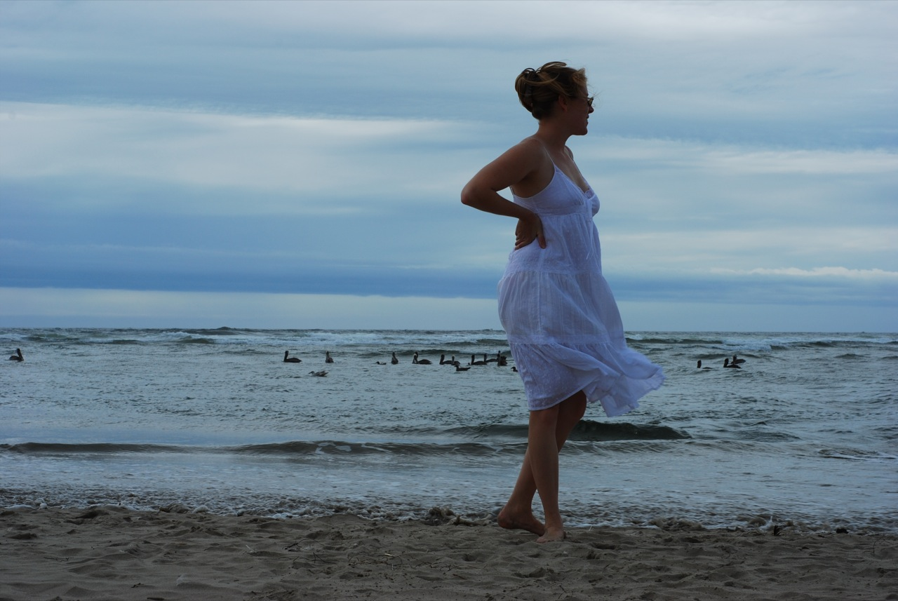 woman on beach in a gauzy windblown dress