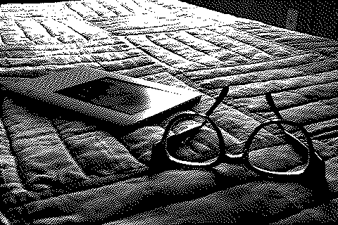 1-bit photo of books & ereader on bed